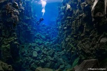 Picture copyright by Magnus Lundgren. Ever been dreaming about diving from one continent to another? Thanks to Magnus stunning picture we can see how it is can be done on Iceland. On one side we see America, on the other Europe. Only in Icelands Thingvellir Fault Zone is it this easy.
