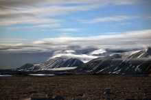 Photograph by Jeff Shea. A range of north Greenland shield volcanoes eroded by glacier ice so that they more remind of a range of strato-volcanoes.