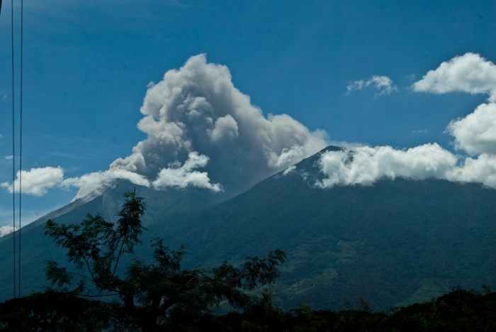 Volcan de Fuego erupting with Acatenango in the forefront.