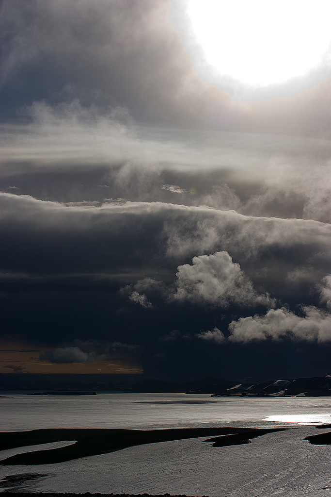 Photograph by Eggert Norddahl under exclusive agreement to Volcano Café. Grimsvötn 2011 eruption, sun over ash cloud.