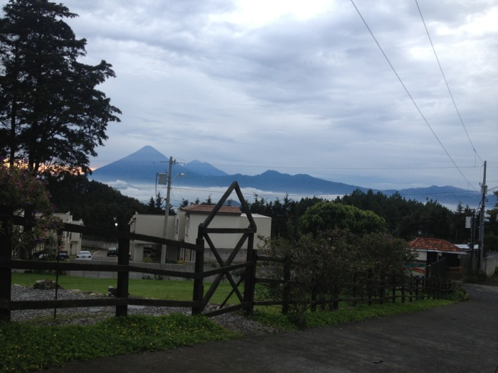 Photograph of the Volcan de Amatitlán with Pacaya in the background. Hidden in the mist is Lago de Amatitlán (Graben formation). The photograph by Dr Carmen Morataya is taken from the caldera wall. Pacaya is situated on the opposit side of the caldera.