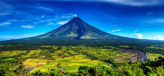 Photograph by Sinjin Pindeda. The photograph is taken from a hill at the outskirts of Legaspi City. Note the lava flow that is hardly even covered by greenery. A couple of more kilometers of lava flow and Legaspi would have been gone.