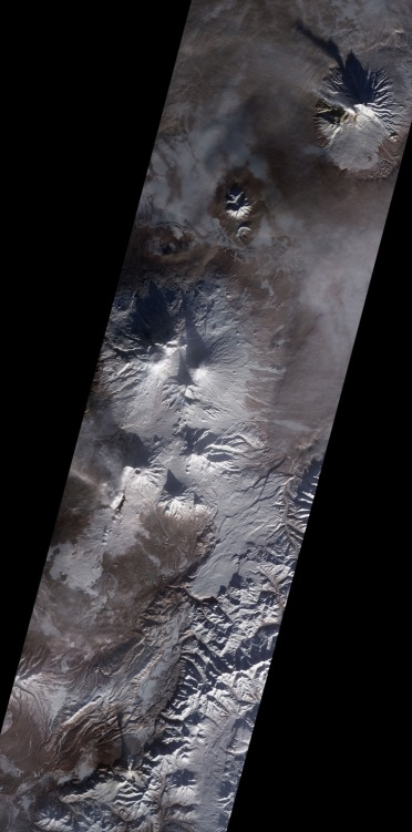 How many erupting volcanoes can you spot here? (answer at end of post!). Amazing ASTER image of Kamchatka recorded on 11 January 2013. (NASA)
