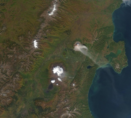 Shiveluch again, but this time imaged by the MODIS sensor on 17 September 2002. As well as the imagery, there is a red dot at the volcano indicating a thermal anomaly. (NASA)