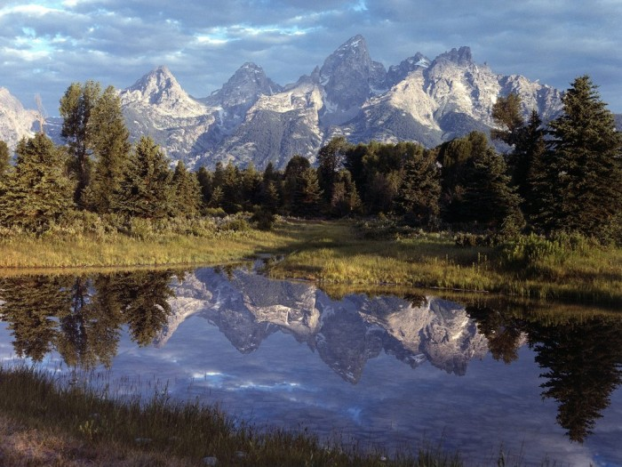 The amazingly beautiful Grand Teton reflecting in a lake that is close to where there has been small scale uplift.