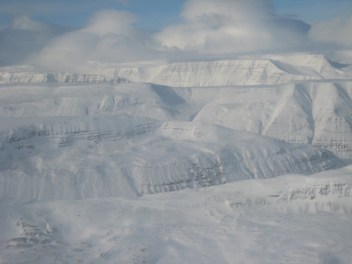 And finally here is a beautiful picture of the trap formation in all it's stunning grandeur. Notice how the Ice has caved out canyons and valleys in the mountain, a tell tale sign of this being an old volcano. Picture found by CBUS.
