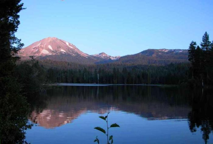 Fig 6. A beautiful sunset view with reflection of the pink Chaos Crags in the still waters of Lake Manzanita. The Chaos Crags, a series of five dacite lava domes, were extruded as recently as 1,100 to 1,000 years ago.  (Sing H. Lin, shltrip.com)