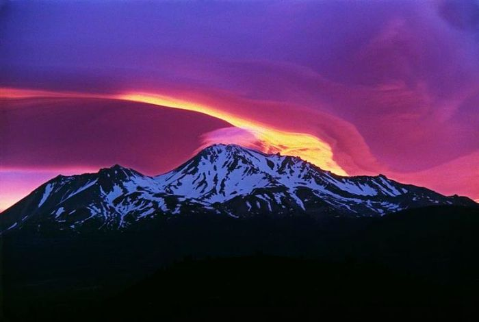 Fig 1. Sunrise at Mount Shasta with the satellite cone Shastina to the left  (Wikimedia Commons).