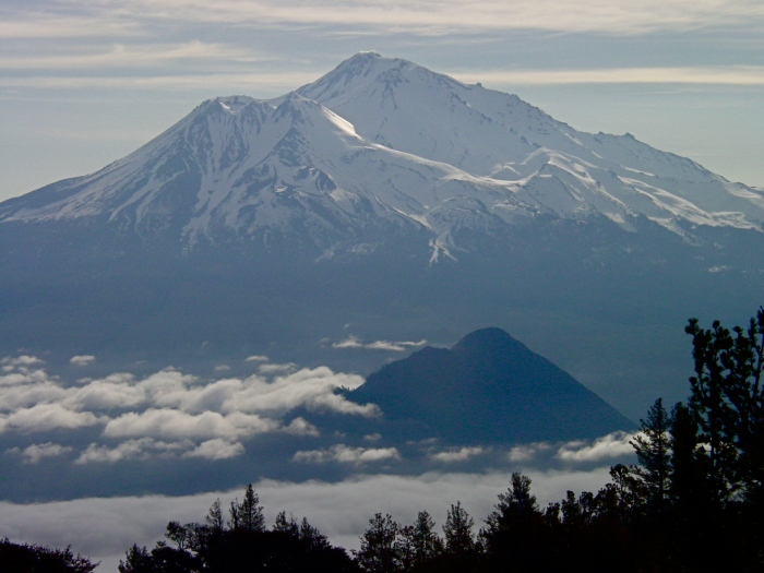 Figure 2. Shasta, Shastina and in the foreground, Black Butte, tiny in comparison in spite of rising more than 600 m above the surrounding landscape itself. (summitpost.org)