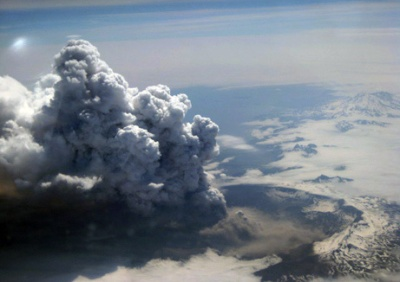 Image of the eruption of Okmok, taken Sunday, July 13, 2008, by flight attendant Kelly Reeves during Alaska Airlines flights 160 and 161. Picture Date: July 13, 2008 Image Creator: Kelly Reeves – Image courtesy of Alaska Airlines.