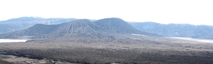 View to the east of the new cone that formed during the 2008 eruption in the caldera at Okmok volcano. The new cone is on the left, and the older Cone D, is the higher peak on the right. Photograph by Janet Schaefer, Alaska Volcano Observatory / Alaska Division of Geological & Geophysical Surveys.