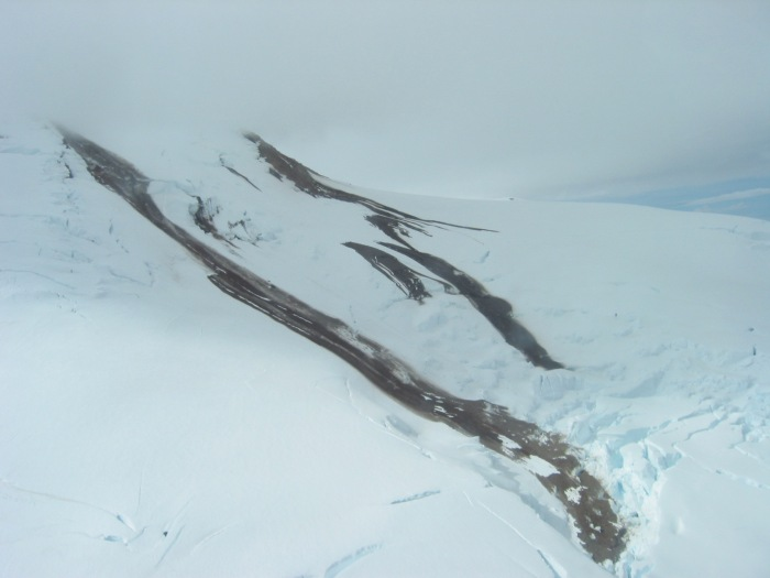 July 15, 2004 overflight to Spurr Volcano.  Images of Crater Peak, debris flows from Spurr summit cone, surrounding glaciers. Photograph by Christina Neal, the Alaska Volcano Observatory/U.S. Geological Survey
