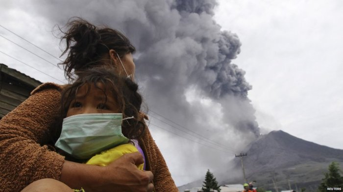 The authorities have issued facemasks to the peope around Sinabung. Photograph by Reuters, fair usage act.