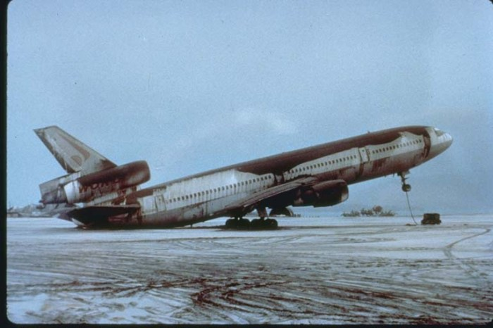 Heavy ash fall from Mount Pinatubo has caused an aircraft to sit on its tail. Photo credit: R.L. Rieger, U.S. Navy.