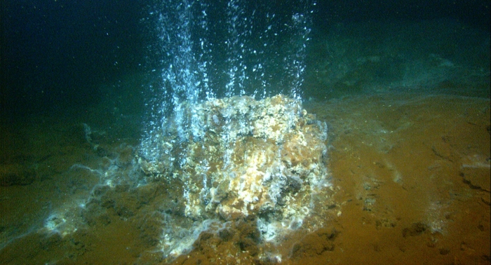 A high-temperature hydrothermal vent in the Kolumbo submarine crater, discharging gases. Photograph from NOAAs expedition in 2006 in the Aegean Ocean.