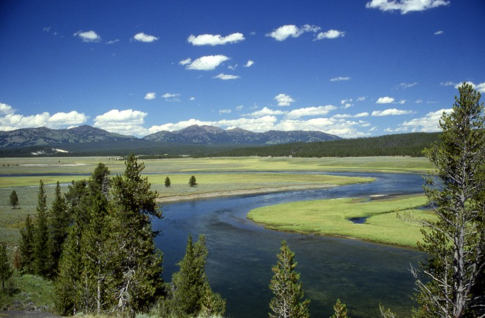 The dormant Yellowstone slowly doing very little while being beautiful. Image from Wikimedia Commons.