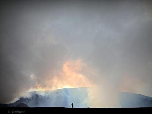 Michael Ross dwarfed by the gas cloud and rim of Marum Crater. Photograph by Bradley Ambrose.