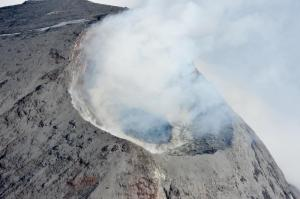 From the interactive map. Description: Aerial photograph of Cleveland's August 2011 lava and summit crater. This lava dome was extruded sometime after July 7 when the last clear view of the summit area did not show this feature. The formation of the lava dome is consistent with thermal anomalies observed in satellite imagery since July 19, 2011. This dome is approximately 60 m in diameter in a 200m-wide crater. Photograph courtesy of Dave Withrow, National Oceanic and Atmospheric Administration.