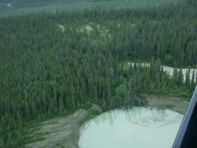 Mud Volcanoes -- http://www.coppervalleyairservice.com/Photo-Gallery/main.php/v/Alaska-Flightseeing-+Wrangell-St-Elias-Nat-Park/PICT0013.JPG.html