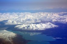 The Katmai complex looking west to east, with Naknek Lake in the foreground, Mt. Griggs and the Valley of Ten Thousand Smokes in the Background.  Photo courtesy AVO, USGS, Cyrus Read, May 9, 2010, http://www.avo.alaska.edu/images/image.php?id=19771