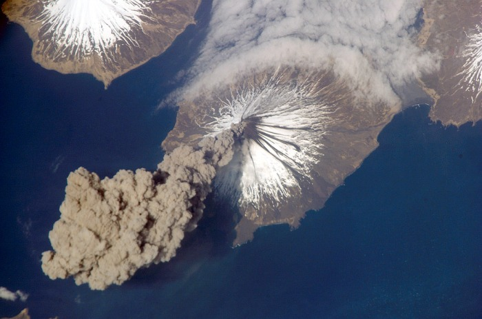 Mount Cleveland erupting photographed from the ISS. Image belongs to NASA/JPL and is from the Wikimedia Commons.