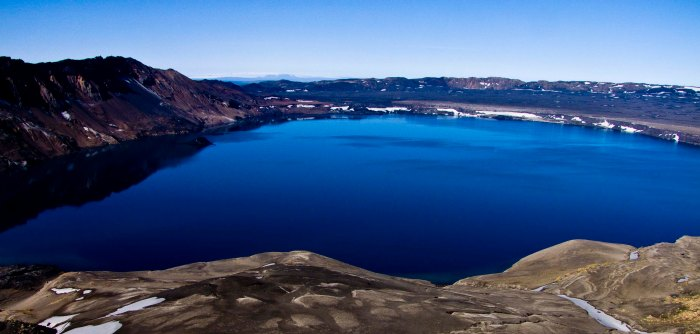 The dark blue beauty of Lake Öskjuvatn with the surrounding outer caldera wall clearly visible. Click on image to see it clearly. Image by unknown.