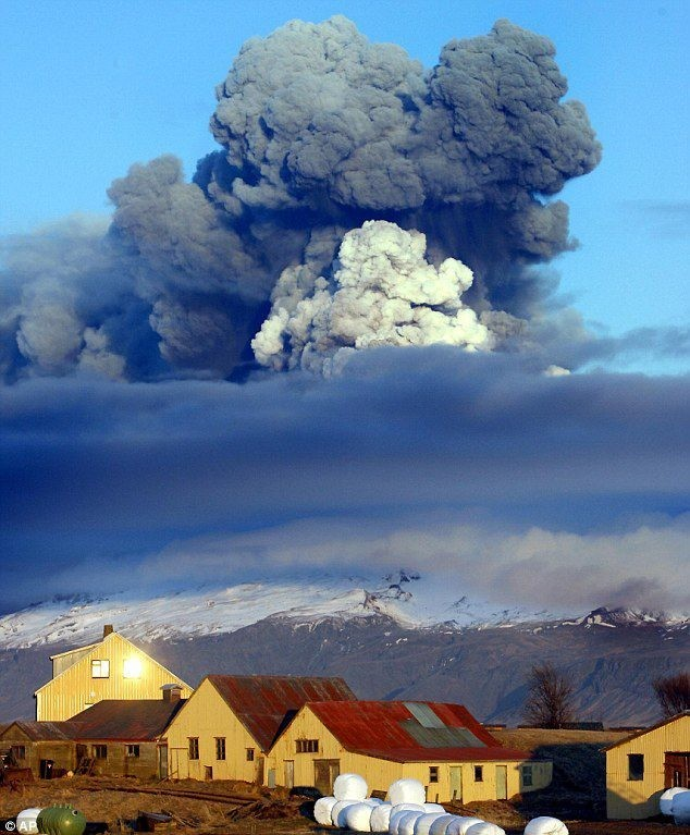The eruption column from Grimsvötn 2011 seen towering above a small village. Photograph by unknown.