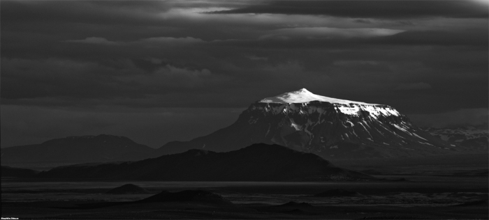 This beautiful black and white image shows Herðubreið with snow on top and the small top tuff cone is clearly visible. Photograph by Skarphéðinn Þráinsson. Click on imge for larger view.