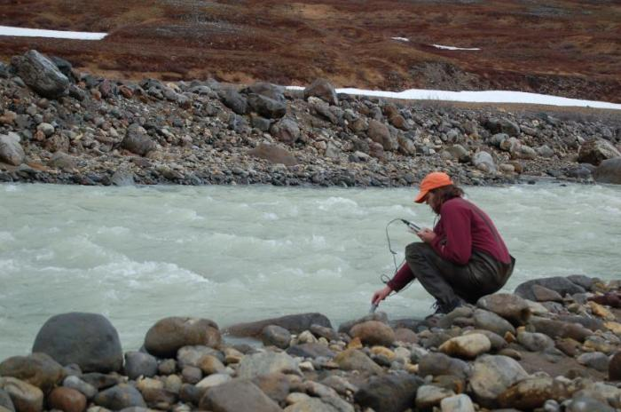 Janet Schaefer testing the highly acidic (pH 1.2) waters of upper Indecision Creek.   Photo courtesy AVO / USGS, June 19, 2006  http://www.avo.alaska.edu/images/image.php?id=10595