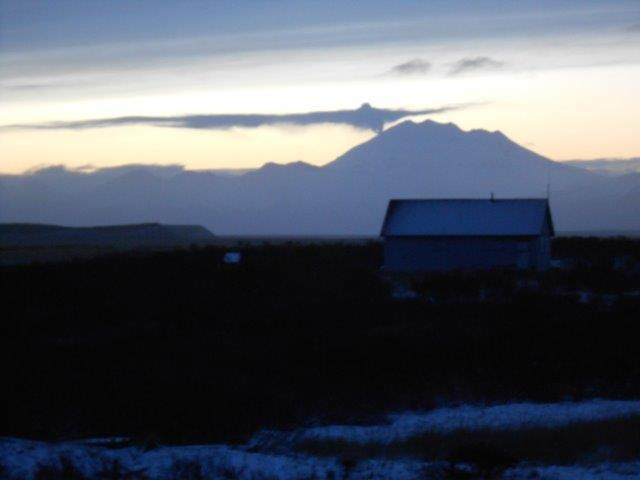 Christmas morning fumarole activity at Chiginagak volcano seen from Ugashik Village  Image courtesy Roland Briggs, Dec 25, 2013   http://www.avo.alaska.edu/images/image.php?id=57601