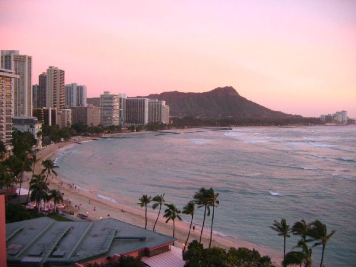 Waikiki twilight with Diamond Peak in the background. Photo by Christopher Chappelear via Flickr (CC-BY).