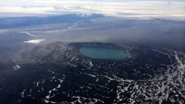 Aerial photograph of the sub-glacially formed Askja volcano with its large caldera containing the nested caldera of Lake Öskjuvötn, which resulted from post-eruption collapse following the volcano's 1875 VEI 5 eruption (RUV)