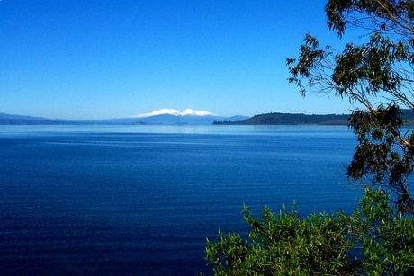 Beautiful Lake Taupo, New Zealand. The only hint of its volcanic origin are the distant volcanoes on the horizon, built at the edges of the ring fault system. (Provenance unknown)