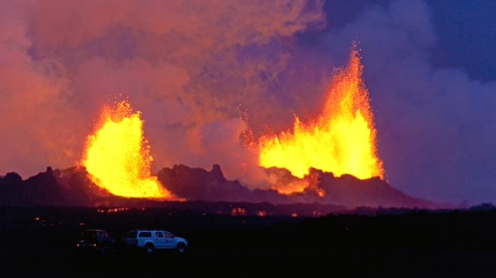Fires at Holuhraun with trucks in the fron for size estimate. Photograph copyright by Eggert Norðdahl and Volcanocafé Productions.