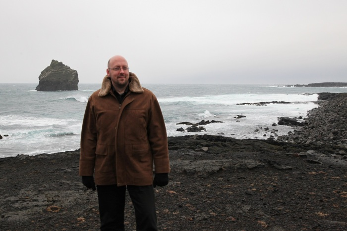 Carl infront of the Karl Rock. A massive old lava plug from an eroded volcanic vent of Reykjanes volcano.