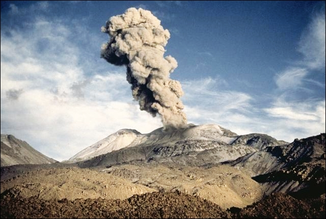 An ash-rich vulcanian eruption plume, viewed from the SE, rises above Sabancaya volcano in northern Perú on April 15, 1991. Strong vulcanian explosions were observed at intervals of 20-30 minutes during an April 13-19 visit to the volcano. The explosions lasted about a minute and produced 3-4 km high ash clouds. Explosive activity at Sabancaya began in May 1990 and was continuing in 1995. Photo by Pierre Vetsch, 1991.